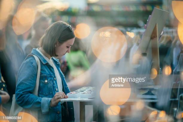 young girl shopping in a  flea market for jewellery in summer, zero waste concept - flea market stock pictures, royalty-free photos & images