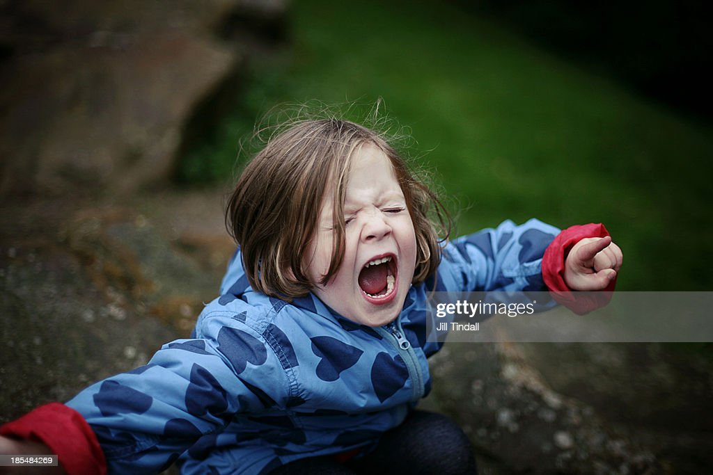 young girl shouting and screaming with mouth open : Stock Photo