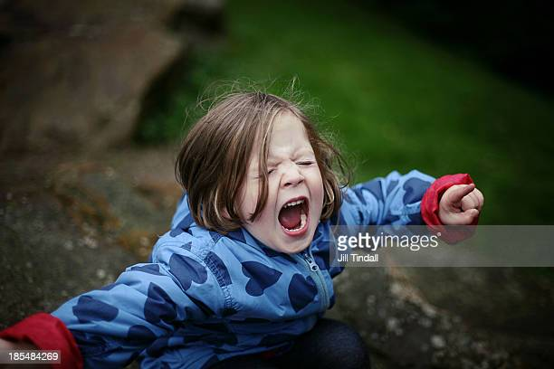 young girl shouting and screaming with mouth open