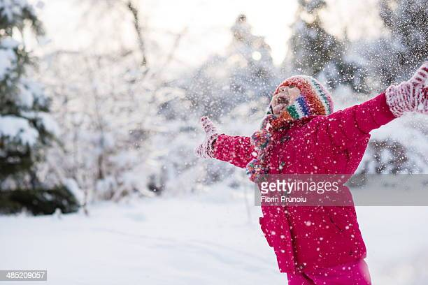 young girl shouting and throwing snow mid air - mitten stock pictures, royalty-free photos & images