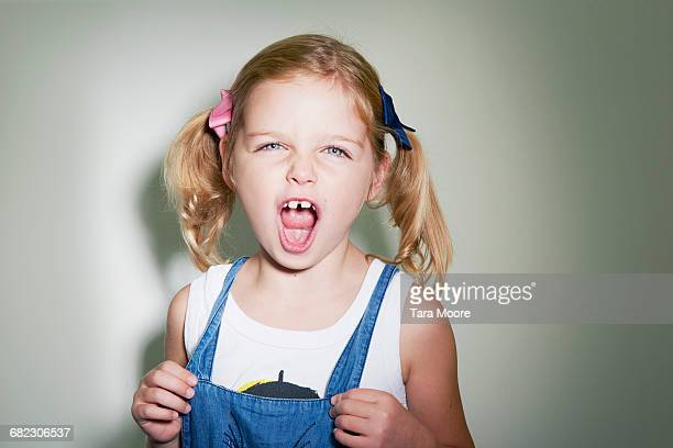 young girl shouting to camera