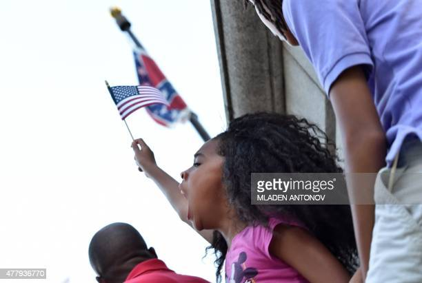 A young girl shouts slogans as hundreds of people gather for a protest rally against the Confederate flag in Columbia South Carolina on June 20 2015...