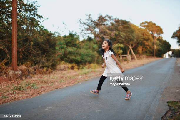young girl (4-5 years) showing her moves on the empty street - 4 5 years stock pictures, royalty-free photos & images