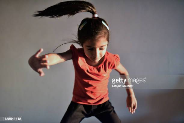 young girl (4-5 years) showing moves - 4 5 years stock pictures, royalty-free photos & images