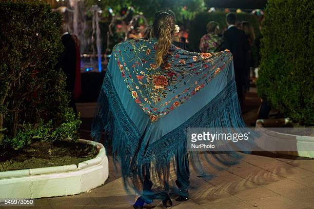 A young girl shows off her shawl in the gardens of the Plaza de Ramales de la Victoria during verbena shawl on July 10 2016 VERBENA SHAWL in Ramales...