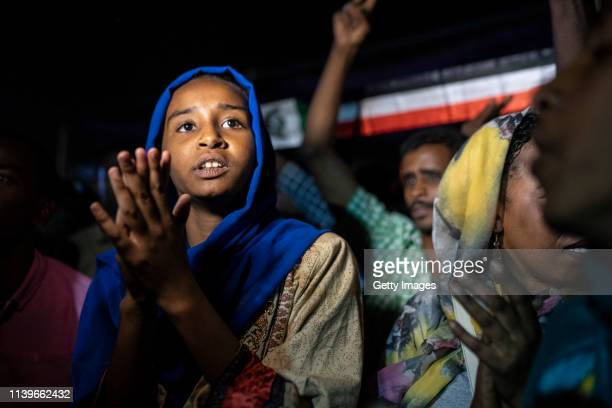 A young girl sings during evening protests against the military junta on April 27 2019 in Khartoum Sudan After months of protesting from the people...