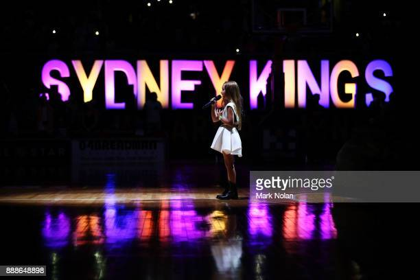 A young girl sings the National Anthem before the round nine NBL match between the Sydney Kings and the Brisbane Bullets at Qudos Bank Arena on...
