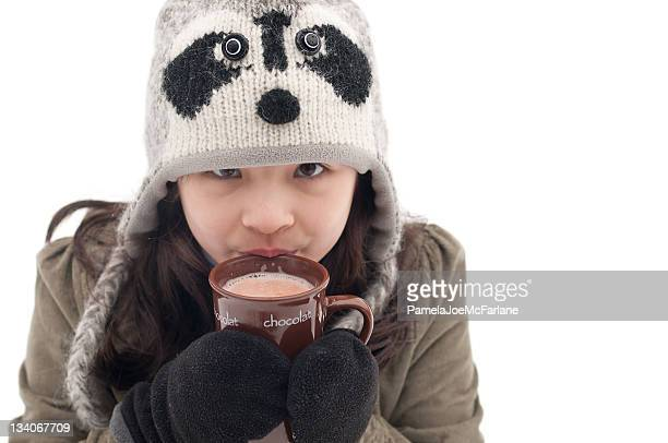 Young Girl Sipping Hot Chocolate Outside