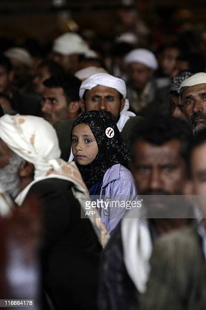 A young girl sits among male supporters of Yemeni President Ali Abdullah Saleh during Friday prayers at alSaleh mosque in Sanaa on June 17 as a top...