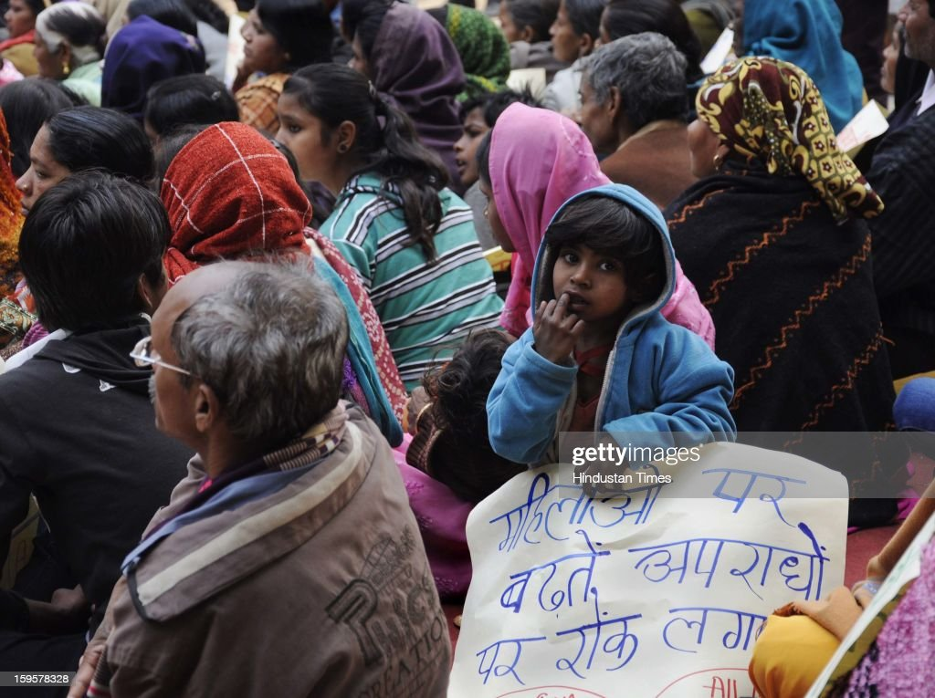 A young girl sits holding a poster during the protest against the alleged inaction by the Indian government regarding the gang rape of a 23-years old student in a bus a month ago, on January 16, 2013 in New Delhi, India. The bus rape has drawn protests and intense media attention. Rapes have become front-page news nearly every day across the country, with demands that police do more to protect women and that the courts treat sexual violence seriously.