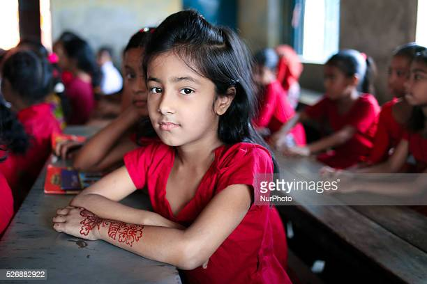 A young girl sits in her school in Dhaka Bangladesh on March 26 2016