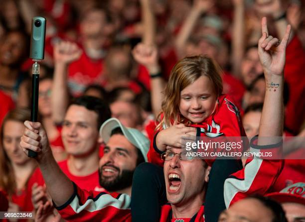 A young girl sits on a man's shoulders as Washington Capitals fans cheer during Game 5 of the Stanley Cup Final against the Vegas Golden Knights at a...
