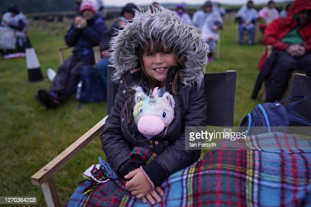 Young girl sits with her toy unicorn as she attends a screening of The Greatest Showman during the Luna Cinema movie experience at Castle Howard on...