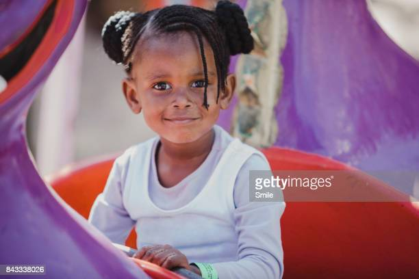 Young girl sitting in theme park ride