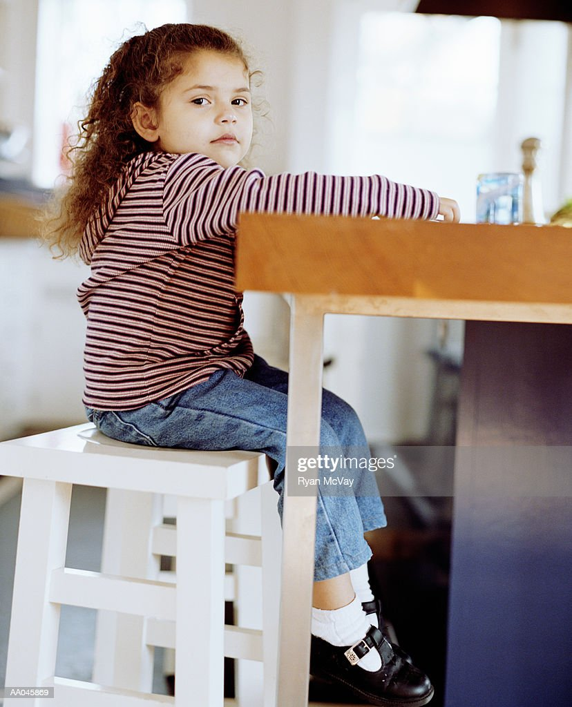 Groovy Young Girl Sitting On Kitchen Stool Stock Photo Getty Images Creativecarmelina Interior Chair Design Creativecarmelinacom