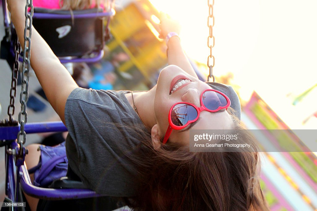 Young girl sitting on swing : Stock Photo