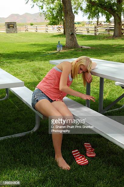 Young girl sitting on table