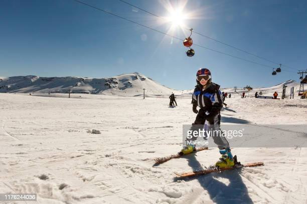 young girl skiing in andes mountain range, chile - ski lift stock pictures, royalty-free photos & images