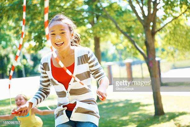 young girl skipping - skipping along stock pictures, royalty-free photos & images