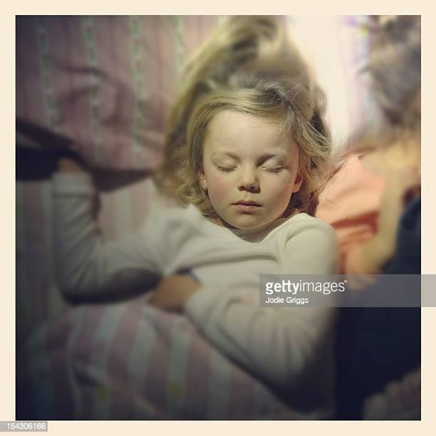 Young girl sleeping in bed