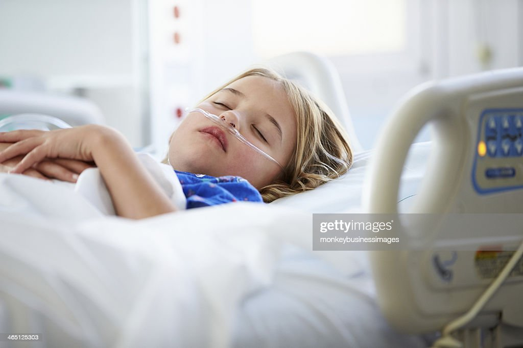 Young Girl Sleeping In Intensive Care Unit : Stock Photo