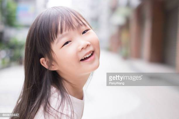 young girl smile to you - cute little asian girls stock photos and pictures