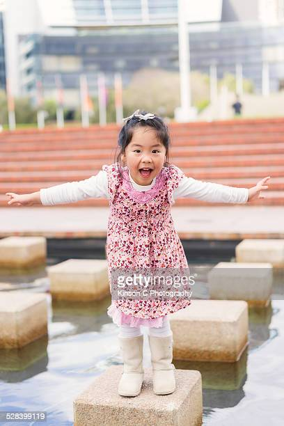 young girl smiles and laughing at camera - darling harbour stock pictures, royalty-free photos & images