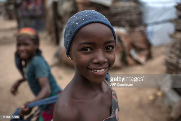 A young girl smiles as she plays in one of the InternallyDisplaced People camps in Gwoza northeastern Nigeria on August 1 2017 Boko Haram seized...