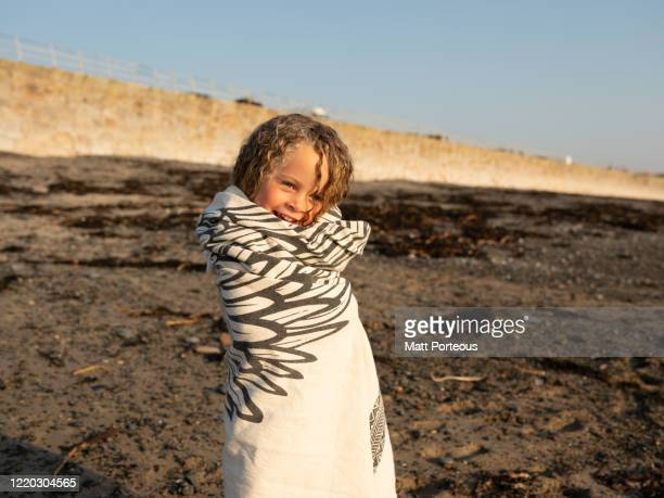 young girl smiling at the beach - surf stock pictures, royalty-free photos & images