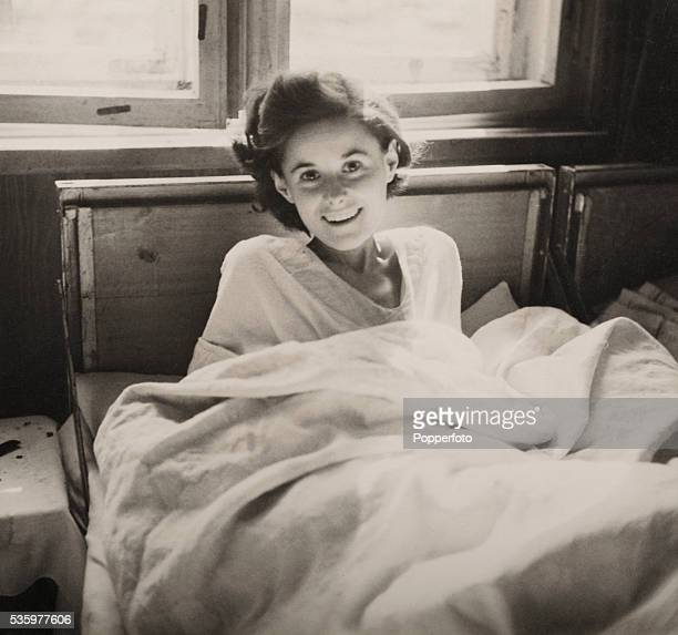 A young girl smiling at the Belsen concentration camp which was liberated by the British Army 15th April 1945 The Royal Army Medical Corps number 11...