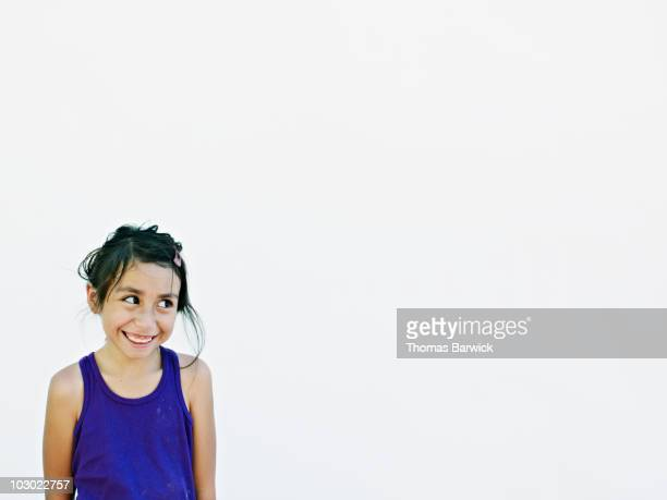 Young girl smiling looking up