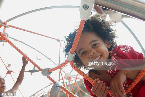 Young girl smiling on climbing gym