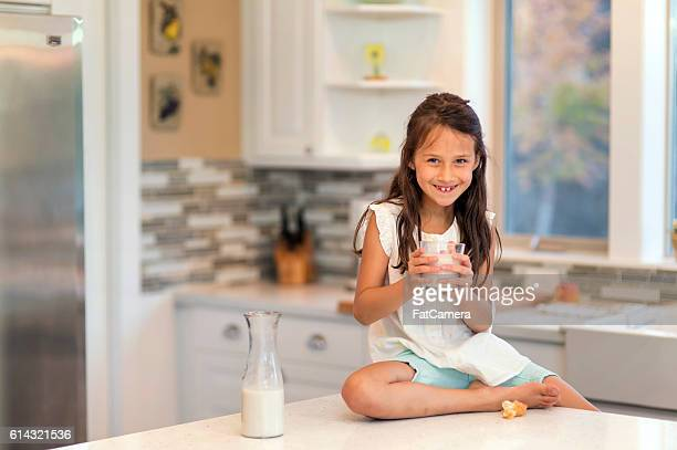 Young girl smiling whole holding a glass of milk