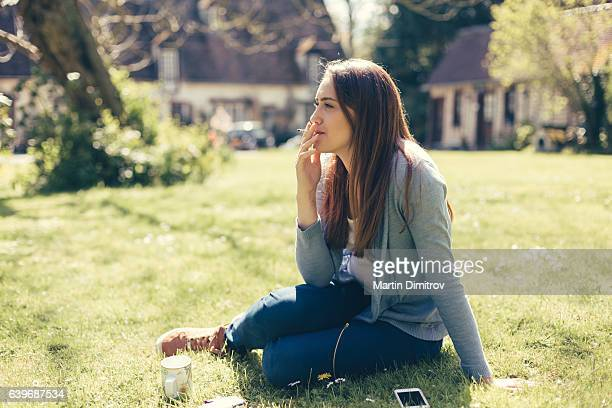 young girl smoking cigarette - little girl smoking cigarette stock photos and pictures