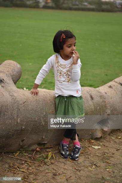 Young girl standing alone with sad face