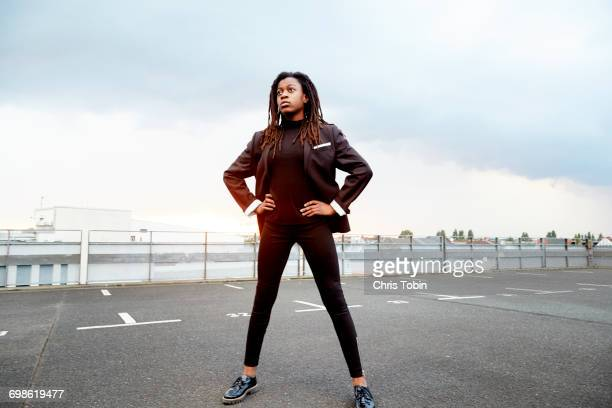 young girl standing in parking lot - physical position stock pictures, royalty-free photos & images