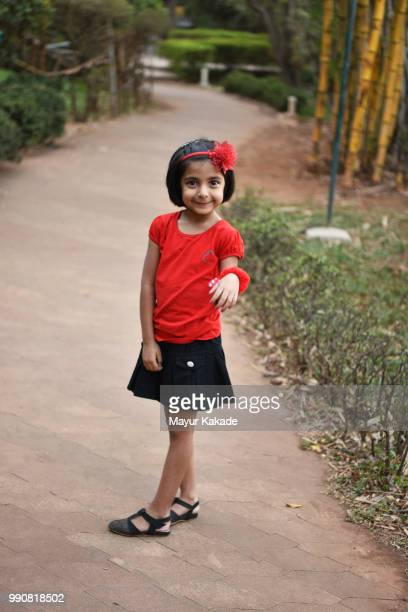 Young girl standing on walkway in the garden
