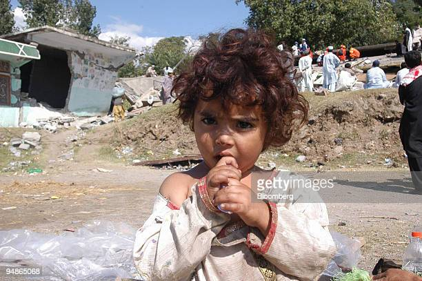 A young girl stands amid the debris of her home in Balakot northern Pakistan on Wednesday October 12 2005 Pakistan's government will immediately send...