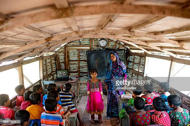 A young girl stands in front of her classmates to give a speech on the solarpowered boat school Shidhulai Swanirvar Sangstha has developed...