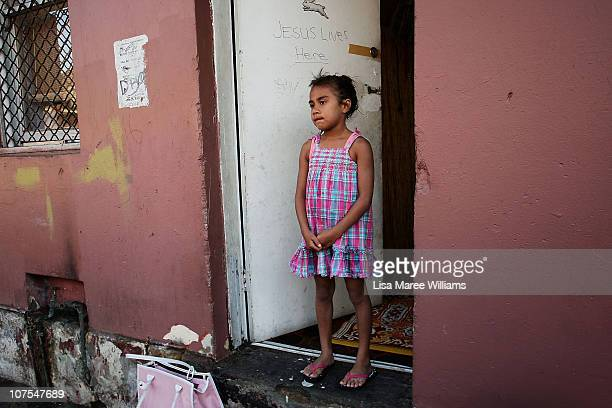 """Young girl stands in the doorway of a home on Vine Street in the Aboriginal housing community known as """"The Block"""" in Sydney, Australia. Thirty-seven..."""