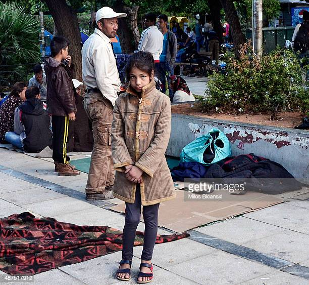 A young girl stands looking at the camera as several hundred migrants mosly from Afghanistan sleep outside on Victoria Square on September 10 2015 in...