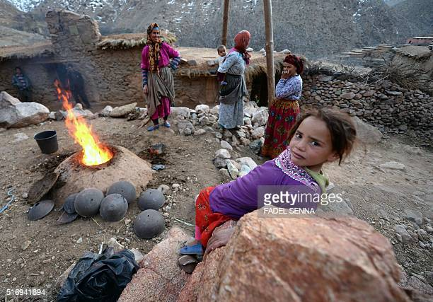 A young girl stands near a traditional oven in Zourhoune an isolated village in the elHaouz province in the High Atlas Mountains south of Marrakesh...