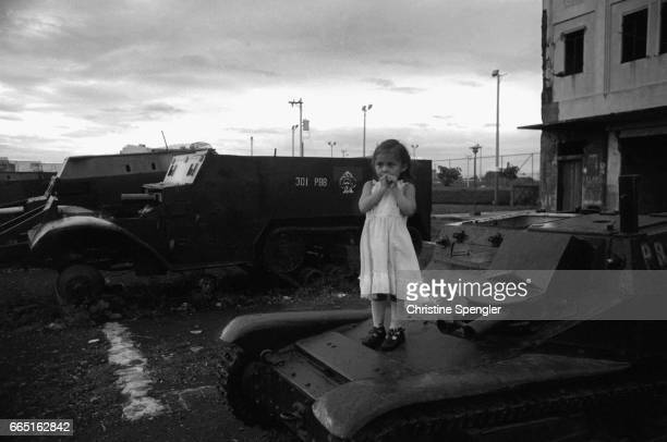 A young girl stands on a tank parked in Louis Alfonso Velasquez Park in Managua Nicaragua Nicaragua plunged into civil war after the Sandinistas took...