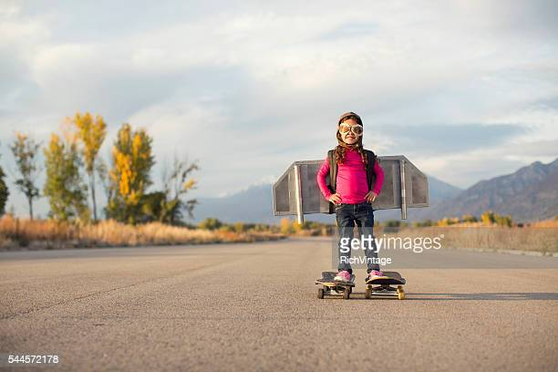 Young Girl Stands on Skateboards While Wearing a Jetpack