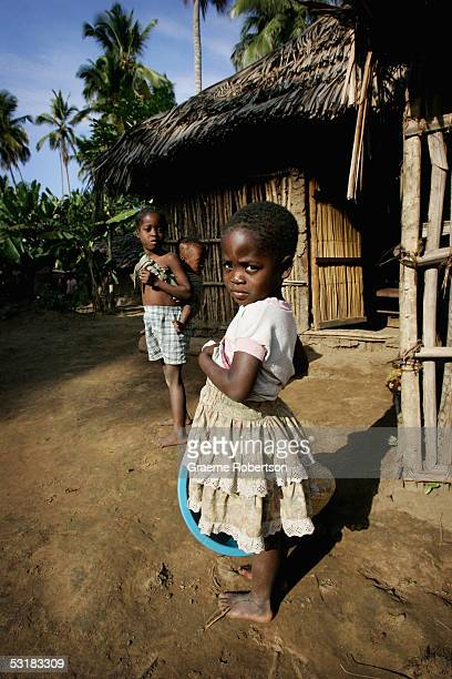 A young girl stands outside her mud hut home in a small village outside Quelimane on July 2 2005 in Mozambique Since Mozambique's 15year civil war...