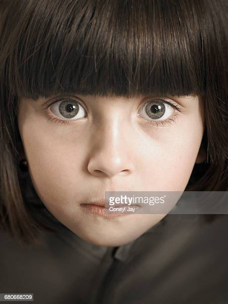 Young girl staring at the camera
