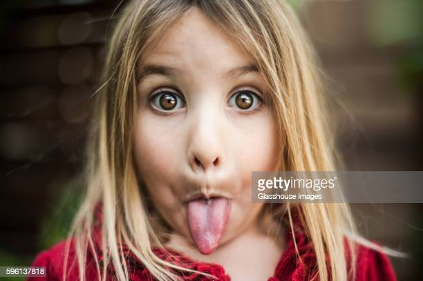 Young Girl Sticking out Tongue, Close-Up
