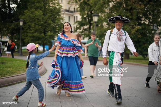 A young girl stops two Mexican World Cup fans for a photograph near Red Square on June 17 2018 in Moscow Russia Today saw the first shock result of...