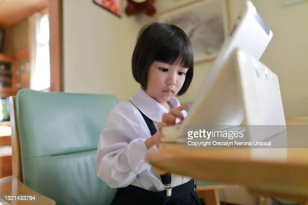 young girl student concentrate learning with digital tablet - saitama prefecture stock pictures, royalty-free photos & images