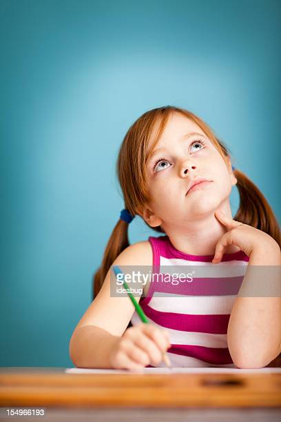 Young Girl Student Thinking in School Desk